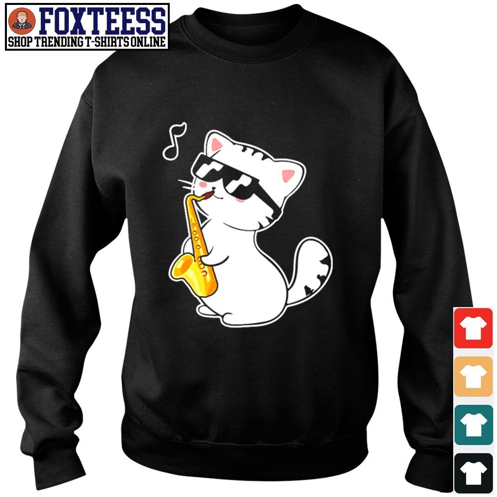 Kitten playing saxophone s sweater
